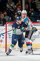 KELOWNA, CANADA - FEBRUARY 13: Calvin Thurkauf #27 of the Kelowna Rockets checks Sami Moilanen #18 of the Seattle Thunderbirds on February 13, 2017 at Prospera Place in Kelowna, British Columbia, Canada.  (Photo by Marissa Baecker/Shoot the Breeze)  *** Local Caption ***