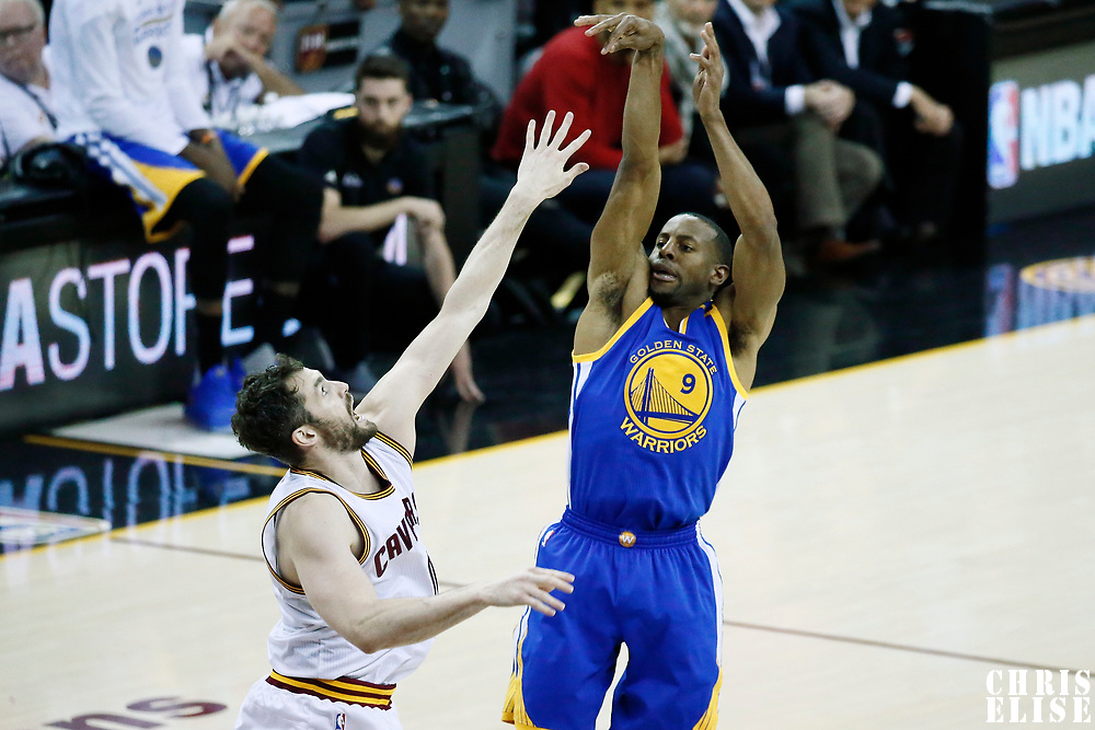 09 June 2017: Golden State Warriors forward Andre Iguodala (9) takes a jump shot over Cleveland Cavaliers forward Kevin Love (0) during the Cleveland Cavaliers 137-11 victory over the Golden State Warriors, in game 4 of the 2017 NBA Finals, at  the Quicken Loans Arena, Cleveland, Ohio, USA.