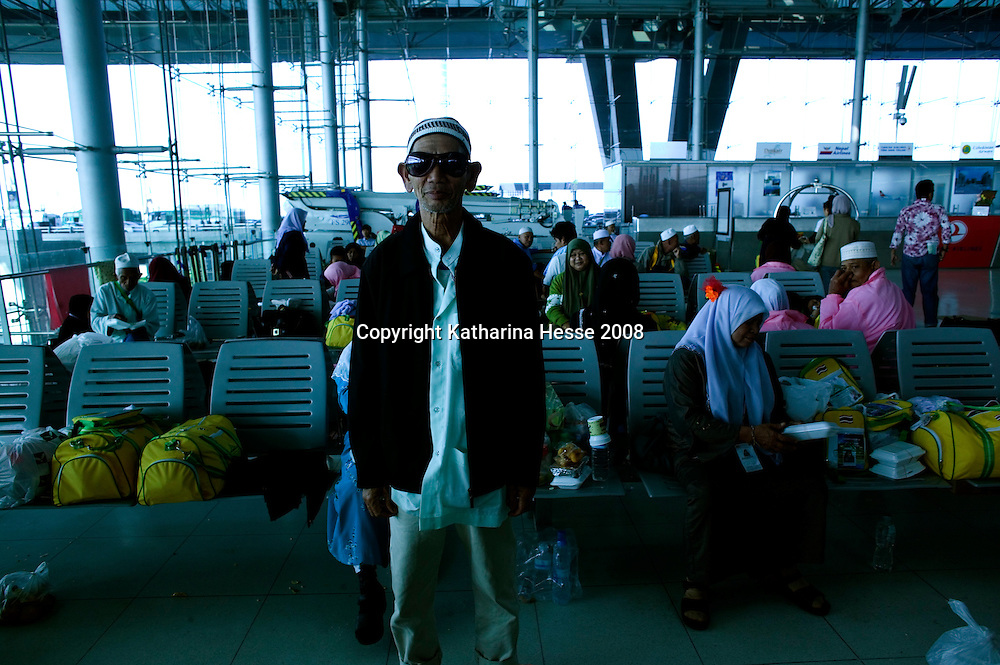 BANGKOK, NOVEMBER 28, 2008: Muslims wait for their departure to Mecca at Bangkok's Suvarnabhumi international airport   on Thursday, November 28th 2008.The campaign by the PAD, which began in earnest in May, has paralysed the Thai government. The group - an alliance of royalists, businessmen and the urban middle class - claim that the government is corrupt and hostile to the monarchy. They also accuse it of being a proxy for former PM Thaksin Shinawatra, who remains very popular among Thailand's rural poor.