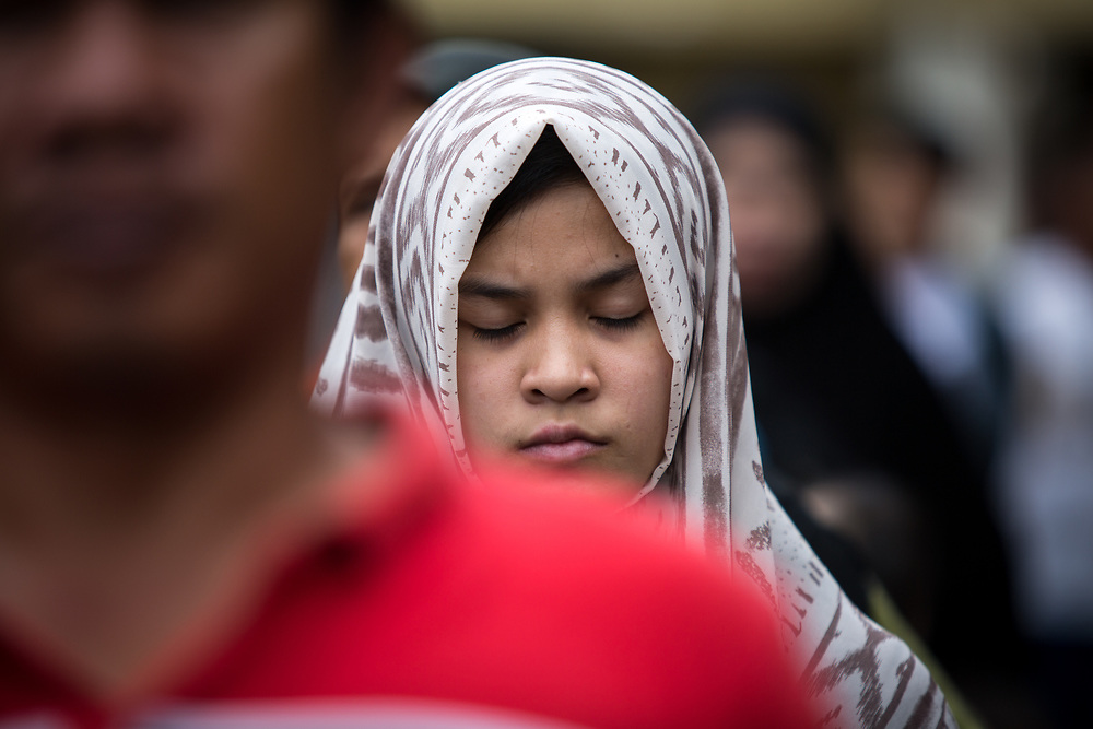 MARAWI, PHILIPPINES - JUNE 12: Muslim resident is seen praying during a symbolic flag raising ceremony in celebration of the Independence Day in Marawi City, Philippines on June 12, 2017. As fighting rages on for the third week, police hung Philippine flags  around war torn Marawi to boost troop morale. (Photo: Richard Atrero de Guzman/NUR Photo)<br />  <br /> <br /> <br /> Residents in tears during Lanao Del Sur Vice Governor Mamintal Adiong's emotional address to the displaced families of Marawi. Local executives and citizens gathered for a symbolic flag raising ceremony to assert civilian authority and unity in celebration of Independence Day in Marawi City, Philippines on June 12, 2017. (Photo: Richard Atrero de Guzman/NUR Photo)