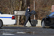 WASHINGTON (Jan 4, 2017) -- A suspiciously stashed violin case containing two firearms near Fletcher's Cove Boathouse on the C&O Canal late Wednesday morning Jan. 4, 2017 is removed from the scene.  More guns and ammunition were also found around the area.  Photo by Johnny Bivera