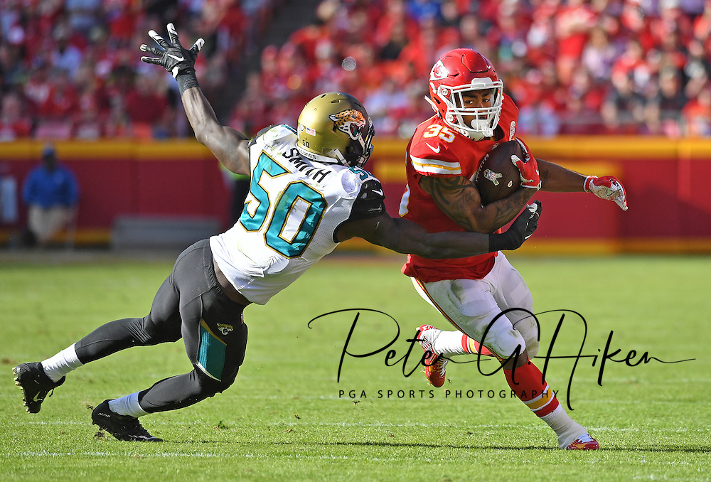 Running back Charcandrick West #35 of the Kansas City Chiefs rushes up field against linebacker Telvin Smith #50 of the Jacksonville Jaguars during the first half on at Arrowhead Stadium in Kansas City, Missouri.