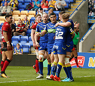 Ben Currie (R) of Warrington Wolves celebrates scoring his try against Bradford Bulls with team mate Morgan Smith  (L)during the Ladbrokes Challenge Cup match at the Halliwell Jones Stadium, Warrington<br /> Picture by Stephen Gaunt/Focus Images Ltd +447904 833202<br /> 21/04/2018