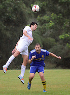 Region I Champion Phoenix Sports Club's Matt Gamble (6) heads the ball as Region II Champion Carpathia Kickers of Michigan's Aaron Krynicki (10) defends in the second half of a semi final in the U.S. Adult Soccer Association over-30 men's championship final four during a rain storm Saturday July 30, 2016 in Feasterville, Pennsylvania. (Photo by William Thomas Cain)