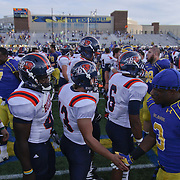 Delaware and Bucknell players meet at midfield to shakes hands after a Week 3 NCAA football game against Bucknell University...#13 Delaware defeated The Bison of Bucknell 19 - 3 at Delaware Stadium Saturday Sept. 15, 2012 in Newark Delaware.