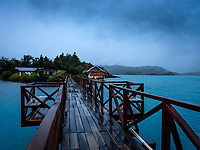NATIONAL PARK TORRES DEL PAINE, CHILE - CIRCA FEBRUARY 2019: Panoramic view of the Paine Lake and Hosteria Pehoé in Torres del Paine National Park, Chile.