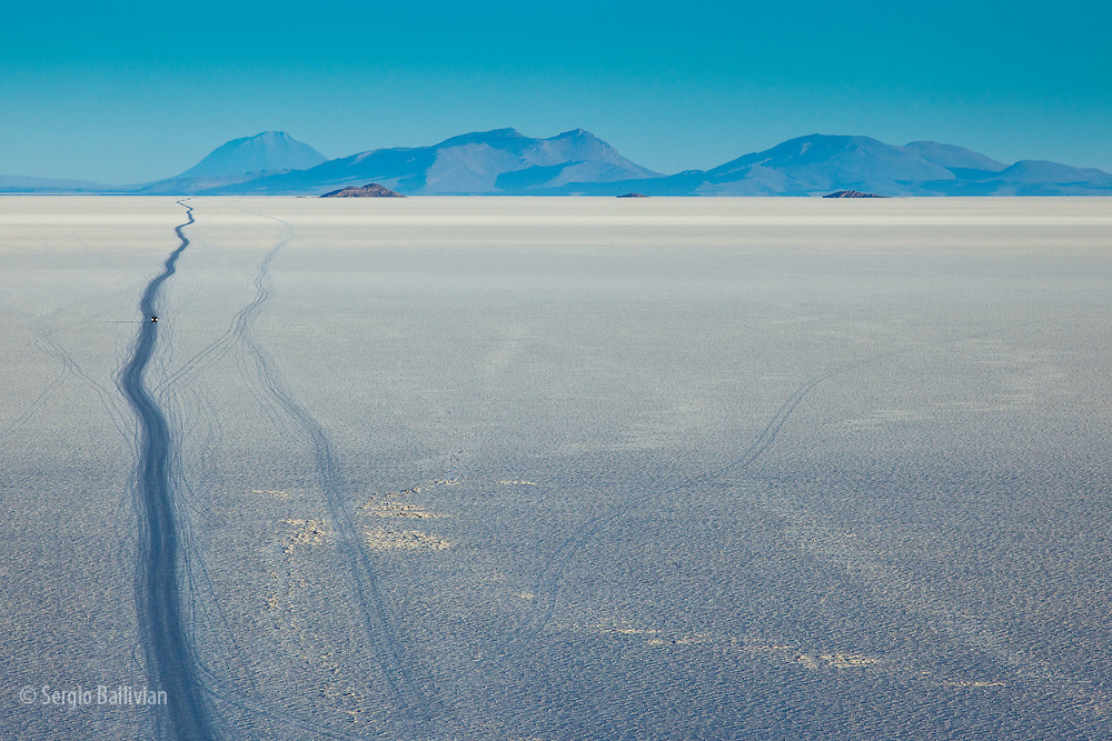 Vehicles are driven on seasonal informal roads that appear on the surface of the Salar de Uyuni in southwest Bolivia.