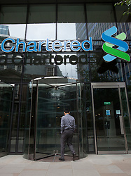 © licensed to London News Pictures. London, UK 07/08/2012. Standard Chartered's HQ in London pictured on 07/08/12. Standard Chartered bank has been accused of hiding $250bn worth of illegal transactions with Iranian banks over nearly a decade. Photo credit: Tolga Akmen/LNP