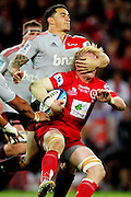 Sonny Bill Williams tackles Beau Robinson during the Super Rugby Final at Suncorp Stadium in Brisbane,  July 9, 2011.  Photo: Patrick Hamilton/Photosport
