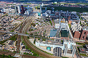 Nederland, Zuid-Holland, Den Haag, 09-05-2013.<br /> Overzicht Den Haag centrum rond het Centraal station  met ministeries, Utrechtsebaan en Prinses Beatrixlaan met Randstadrail en station De Netkous. Nationale Nederlanden, Post NL, Pensioenfonds  MN, Deloitte, Equinox, boven in beeld het Haagse Bos,  Benoordenhout, Malieveld, Malietoren , Koninklijke Bibliotheek, Koninklijk Conservatorium, de Hoftoren (Vulpen). <br /> Overview surroundings central station The Hague,  constructed highrise building, WTC, Post and others. Light rail station Netkous (=Fishnet stocking), near the central station.<br /> luchtfoto (toeslag op standard tarieven)<br /> aerial photo (additional fee required)<br /> copyright foto/photo Siebe Swart