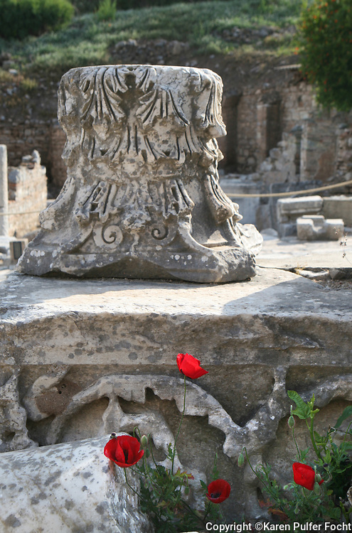 June 1, 2014 - Poppies grow out of ancient ruins. The ancient city of Ephesus (Turkish: Efes), located near the Aegean Sea in modern day Turkey, was one of the great cities of the Greeks in Asia Minor and home to the Temple of Artemis, one of the Seven Wonders of the World. Today, the ruins of Ephesus are a major tourist attraction, especially for travelers on Mediterranean cruises. Ephesus is also a sacred site for Christians due to its association with several biblical figures, including St. Paul, St. John the Evangelist and the Virgin Mary.