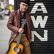 "WASHINGTON,DC - MAR19: Justin Cannon, the founder of The Quitters Club, holds a guitar outside a pawn shop on 14th Street in Washington, DC, March 19, 2015. He's quit efforts at film making, graphic design, fashion, and music. The tagline of the Quitters Club is, ""Let's give up on our dreams together."" (Photo by Evelyn Hockstein/For The Washington Post)"