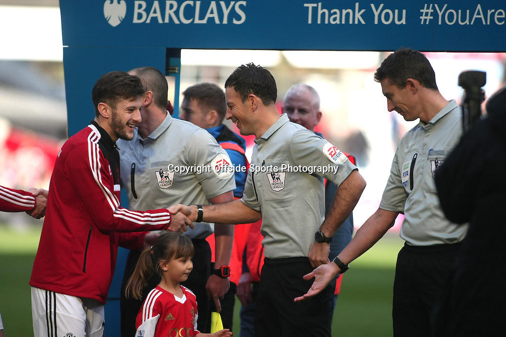 22 February 2014 - Barclays Premier League - West Ham United v Southampton - Adam Lallana of Southampon and referee Mark Clattenburg shakes hands before the match.