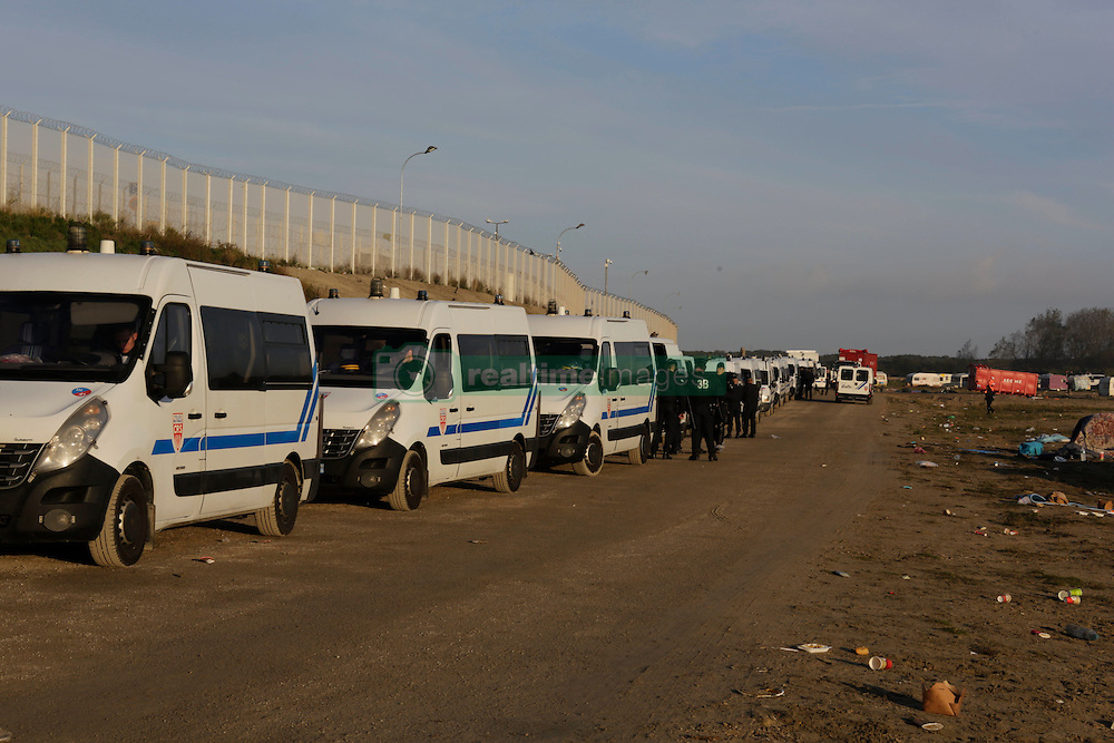 October 27, 2016 - Calais, Nord-Pas-de-Calais-Picardie, France - A long row of police vans stands at the edge of the Jungle. The 4th day of the eviction of the jungle in Calais saw the continue demolition of the huts in the Jungle, as well as the first arrests of people who didn'Äôt leave and some minor clashes with activists opposed to the eviction. (Credit Image: © Michael Debets/Pacific Press via ZUMA Wire)
