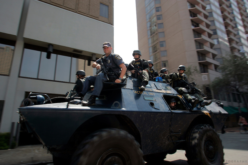 Heavily armed State Police officers ride atop an armored vehicle towards the french quarter Wednesday, August 31, 2005, in downtown New Orleans, La. Scott Morgan