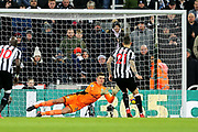 Nick Pope (#29) of Burnley saves the penalty kick from Joselu (#21) of Newcastle United during the Premier League match between Newcastle United and Burnley at St. James's Park, Newcastle, England on 31 January 2018. Photo by Craig Doyle.