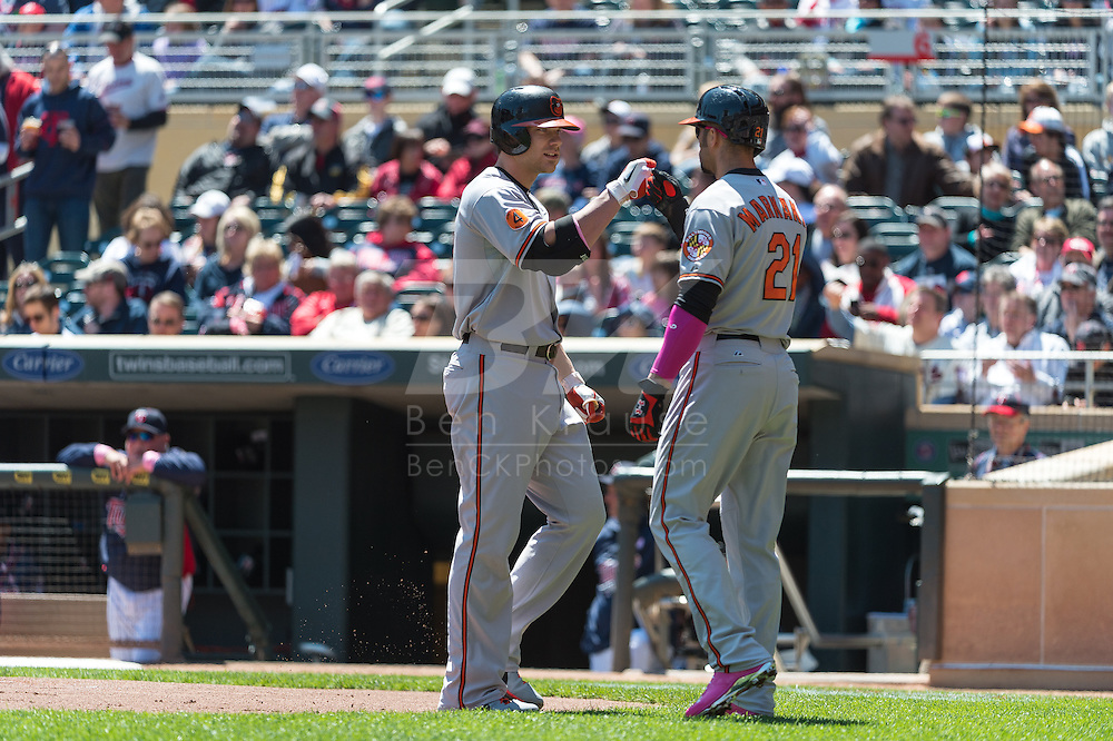 Chris Davis #19 of the Baltimore Orioles is congratulated by teammate Nick Markakis #21 after hitting a home run against the Minnesota Twins on May 12, 2013 at Target Field in Minneapolis, Minnesota.  The Orioles defeated the Twins 6 to 0.  Photo: Ben Krause