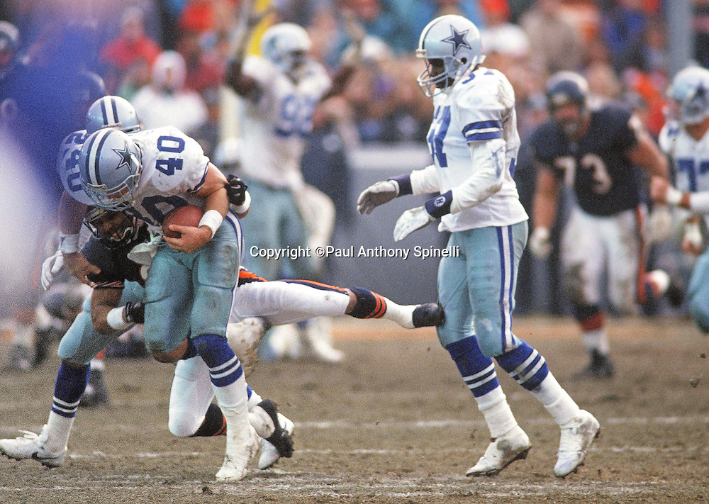 Dallas Cowboys strong safety Bill Bates (40) gets tackled by Chicago Bears running back Dennis Gentry (29) after making a game sealing interception during the NFL NFC Wild Card playoff football game against the Chicago Bears on Dec. 29, 1991 in Chicago. The Cowboys won the game 17-13. (©Paul Anthony Spinelli)