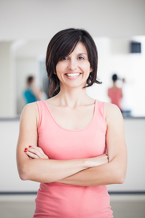 Portrait of a smiling woman ready to exercise.