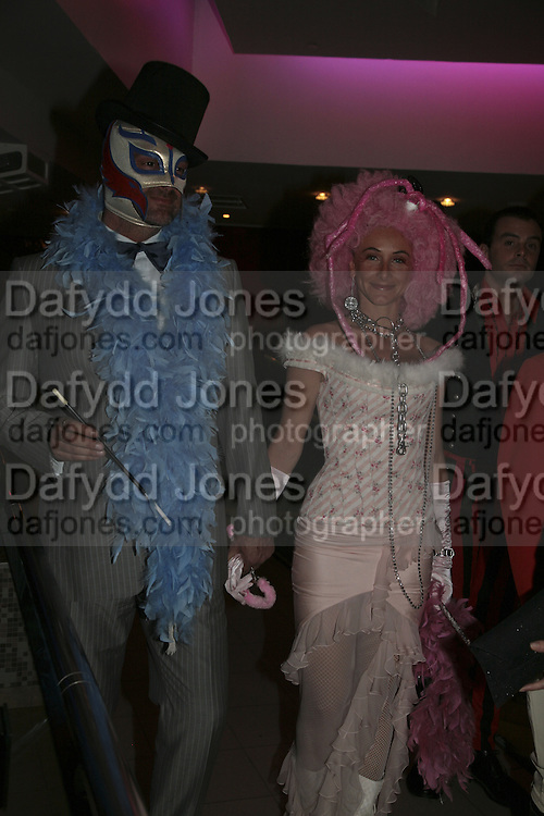 Ray Stevenson and Elizabetta Caraccia, Andy and Patti Wong's Chinese New Year of the Pig party. Madame Tussauds. ( Dress Burlesque, Debauched or Hollywood Black Tie. ) London. 27 January 2007.  -DO NOT ARCHIVE-© Copyright Photograph by Dafydd Jones. 248 Clapham Rd. London SW9 0PZ. Tel 0207 820 0771. www.dafjones.com.