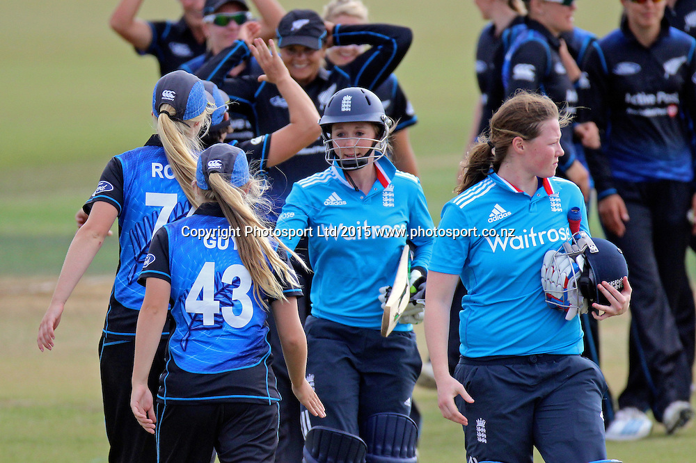 The White Ferns and England complete the 1st ODI with New Zealand winning by 67 runs. 1st one day international, womens cricket match at Bay Oval, Mt Maunganui, 11 February 2015. Copyright Photo: Margot Butcher / www.photosport.co.nz