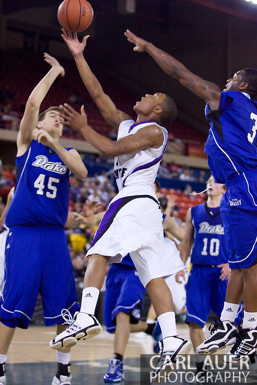 November 27th, 2010:  Anchorage, Alaska - Weber State junior guard Damian Lillard (1) finger rolls a shot up in the Wildcats 82-81 victory over the Drake Bulldogs in the third place game of the Great Alaska Shootout.