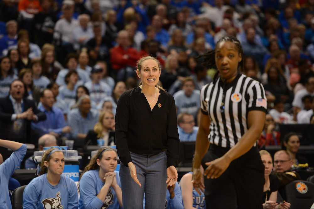 Coach Carla Berube looks to referee for foul call explanation during the NCAA Div. III championship game.