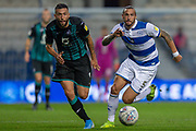 Swansea City forward Borja González (9) and Queens Park Rangers defender Geoff Cameron (5) battle for possession during the EFL Sky Bet Championship match between Queens Park Rangers and Swansea City at the Kiyan Prince Foundation Stadium, London, England on 21 August 2019.