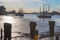 Woolwich, London, September 14th 2016. The afternoon sun illuminates the skyscrapers of Docklands and the Tall ships gathered for the Sail Greenwich Festival 2016 on the River Thames at Woolwich.  ©Paul Davey<br /> FOR LICENCING CONTACT: Paul Davey +44 (0) 7966 016 296 paul@pauldaveycreative.co.uk