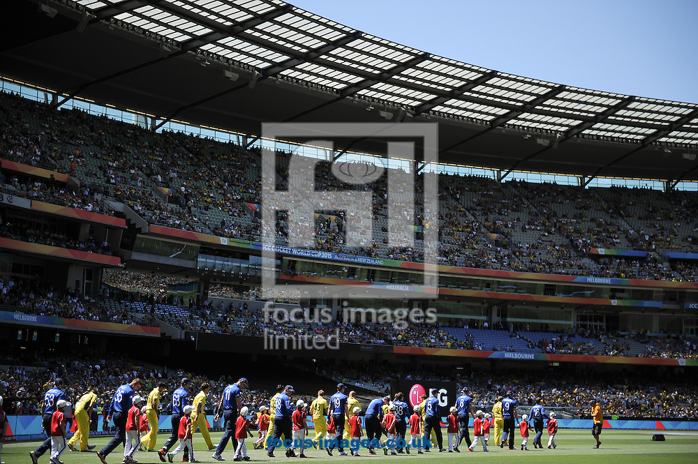 Players walk into the stadium during the 2015 ICC Cricket World Cup match at Melbourne Cricket Ground, Melbourne<br /> Picture by Frank Khamees/Focus Images Ltd +61 431 119 134<br /> 14/02/2015