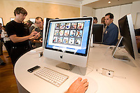 CUPERTINO, CA - AUGUST 7: People check out the new iMac after Apple CEO Steve Jobs introduces new versions of the iMac and iLife applications August 7, 2007 in Cupertino, California. The all-in-one desktop computers now have a slimmer design in aluminum casings with faster chips and glossy screens and is up to $300 cheaper then their predecessors.  (Photograph by David Paul Morris)