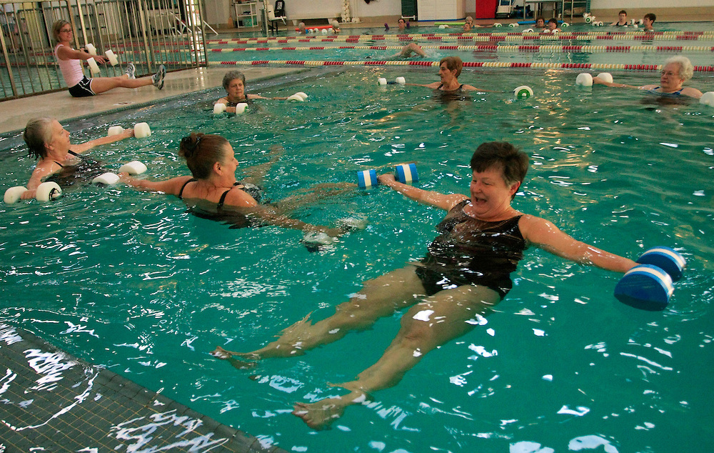 Pat Johnson, right, shares a laugh with her classmates during a deep water hydrobics class at the Athens YMCA as instructor Tanya Beedle, upper left, leads the class.  Beedle said when she first started teaching the course, the class told her to work them harder.