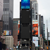 A Times Square digital board has turned black in recognition of the killing of George Floyd by a Minnesota Police Officer on Tuesday, June 2, 2020 in Manhattan, New York.  A citywide 8 p.m. curfew was ordered by NY Mayor Bill de Blasio amid the Floyd protests. (Alex Menendez via AP)