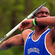 A competitor in the Drake Relays decathlon takes dead aim during competition in 2005.  photo by david peterson