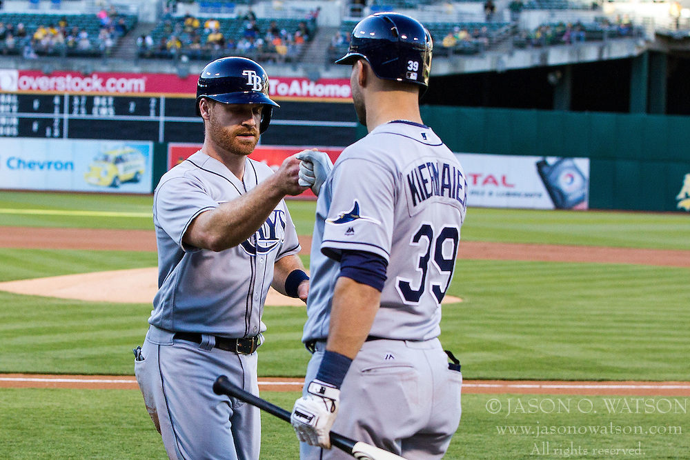 OAKLAND, CA - JULY 21:  Logan Forsythe #11 of the Tampa Bay Rays is congratulated by Kevin Kiermaier #39 after scoring a run against the Oakland Athletics during the first inning at the Oakland Coliseum on July 21, 2016 in Oakland, California. (Photo by Jason O. Watson/Getty Images) *** Local Caption *** Logan Forsythe; Kevin Kiermaier