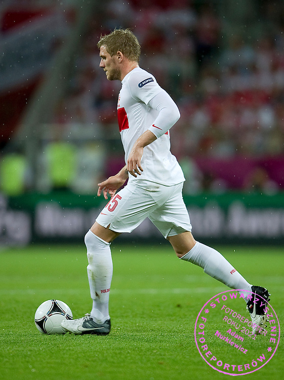 Poland's Damien Perquis (nr15) controls the ball during the UEFA EURO 2012 Group A football match between Poland and Czech Republic at Municipal Stadium in Wroclaw on June 16, 2012...Poland, Wroclaw, June 16, 2012..Picture also available in RAW (NEF) or TIFF format on special request...For editorial use only. Any commercial or promotional use requires permission...Photo by © Adam Nurkiewicz / Mediasport