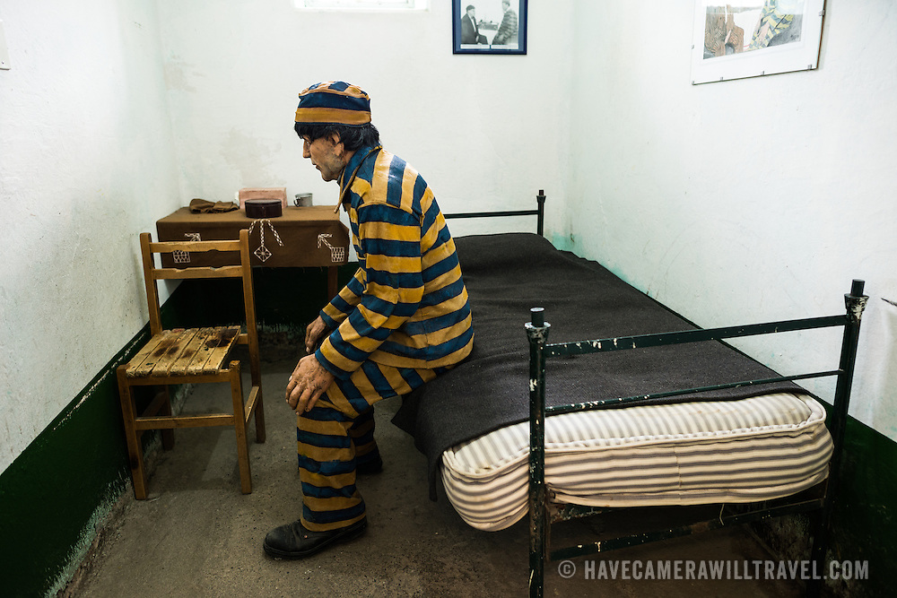 Models depicting prison life on display in cells at the Maritime Museum of Ushuaia. The museum consists of several wings devoted to maritime history, Antarctic exploration, an art gallery, and a policy and penitentiary museum. The complex is housed in an historic prison building and uses the original cells and offices as exhibit spaces.
