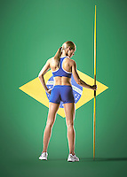 Full length rear view of a female athlete holding javelin against white background