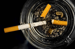File photo dated August 27, 2010 of cigarettes in an ashtray. A French study found that only 4.4% of 350 coronavirus patients hospitalized were regular smokers and 5.3% of 130 homebound patients smoked. This pales in comparison with at least 25% of the French population that smokes. Researchers theorized nicotine could prevent the virus from infecting cells or that nicotine was preventing the immune system from overreacting to the virus. To test this theory, hospitalized coronavirus patients, intensive care patients and frontline workers nicotine patches. Photo by ANDBZ/ABACAPRESS.COM