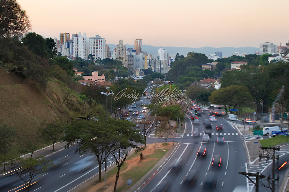 View of Av. Sumare traffic looking towards Perdizes disrtrict at dusk, Sao Paulo, Brazil.