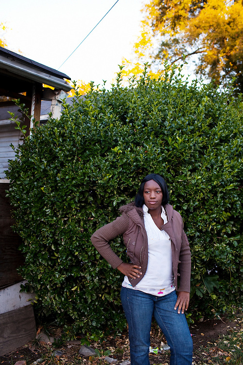 """Bianca"" posing for a portrait in front of her home in the Baptist Town neighborhood of Greenwood, Mississippi on Thursday, November 4, 2010."