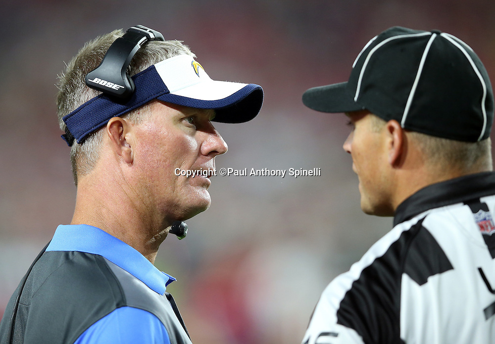 San Diego Chargers head coach Mike McCoy talks to an official on the sideline during the 2015 NFL preseason football game against the Arizona Cardinals on Saturday, Aug. 22, 2015 in Glendale, Ariz. The Chargers won the game 22-19. (©Paul Anthony Spinelli)