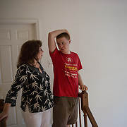 ROCKVILLE, MD - JUL25: John Bucknam, 18, with his mom Barbara, wears a shirt to sleep in only which alerts people to the fact that he has autism if he is found alone and to call 911, July 25, 2014 in Rockville, MD. The Bucknam's have a series of locks on their doors to keep John from wandering off. (Photo by Evelyn Hockstein/For The Washington Post)