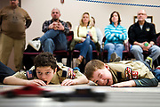 BROOKFIELD, WI -FEB. 28, 2015: Peter Williams, 9, left, and Parker Schmitt, 10, closely watch the Pinewood Derby cars race by them. Cub Scout Pack 45 gathers at City Hall in Brookfield, WI Saturday, Feb. 28 for the Pinewood Derby. Lauren Justice for The New York Times