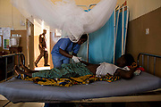 KABALA, SIERRA LEONE - Nurse Fatumata B Samuna (C) checks patient Saio Marah (R) at the Antenatal Ward of Kabala General Hospital on November 10, 2017 in Kabala, Sierra Leone. Photo by Xaume Olleros / MSF