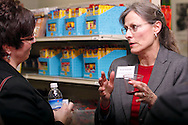 Denise Eckley (left) and Beverly Armstrong of MPS Weight Loss & Wellness during a BBB networking event at Crayons to Classrooms in Dayton, Tuesday, February 28, 2012.