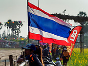 17 FEBRUARY 2018 - BAN LOT, PHETCHABURI, THAILAND: Spectators at ox cart races in Ban Lat, a community about three hours south of Bangkok. The ox cart races are almost 100 years old, and date back to the reign of King Rama V. The races are run on a 100 meter long straightaway course.   PHOTO BY JACK KURTZ