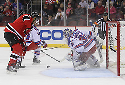 Nov 5, 2010; Newark, NJ, USA;  New York Rangers goalie Henrik Lundqvist (30) makes a save on a shot by New Jersey Devils right wing Dainius Zubrus (8) during the first period at the Prudential Center.