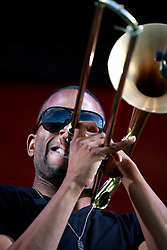 05 May 2013. New Orleans, Louisiana,  USA. .New Orleans Jazz and Heritage Festival. JazzFest..Troy Trombone Shorty and his band Orleans Avenue close the festival on the Acura stage..Photo; Charlie Varley