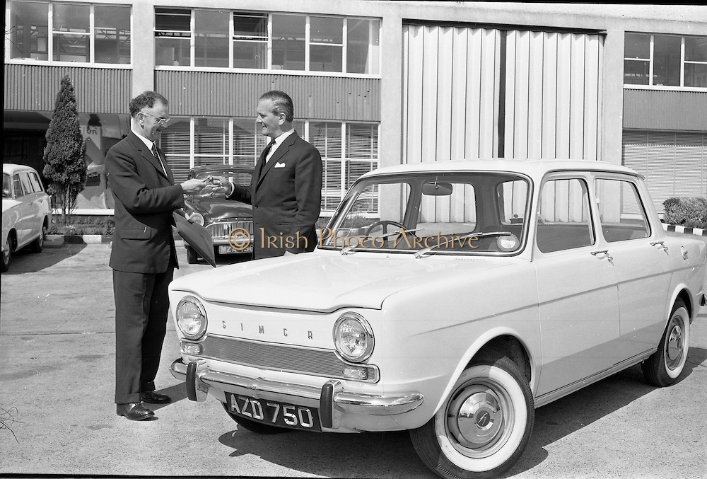 04/08/1962<br /> 08/04/1962<br /> 04 August 1962 <br /> Handing over Simca 1,000 to French Attache at McCairns Motors Ltd., Santry, Dublin. Picture shows the first Irish assembled Simca 1,000 being handed over by Mr Patrick Flanagan (left), general Works Manager, McCairns Motors Ltd. to the French Commercial Attache M. A. de Viggiani of the French Embassy, Dublin.